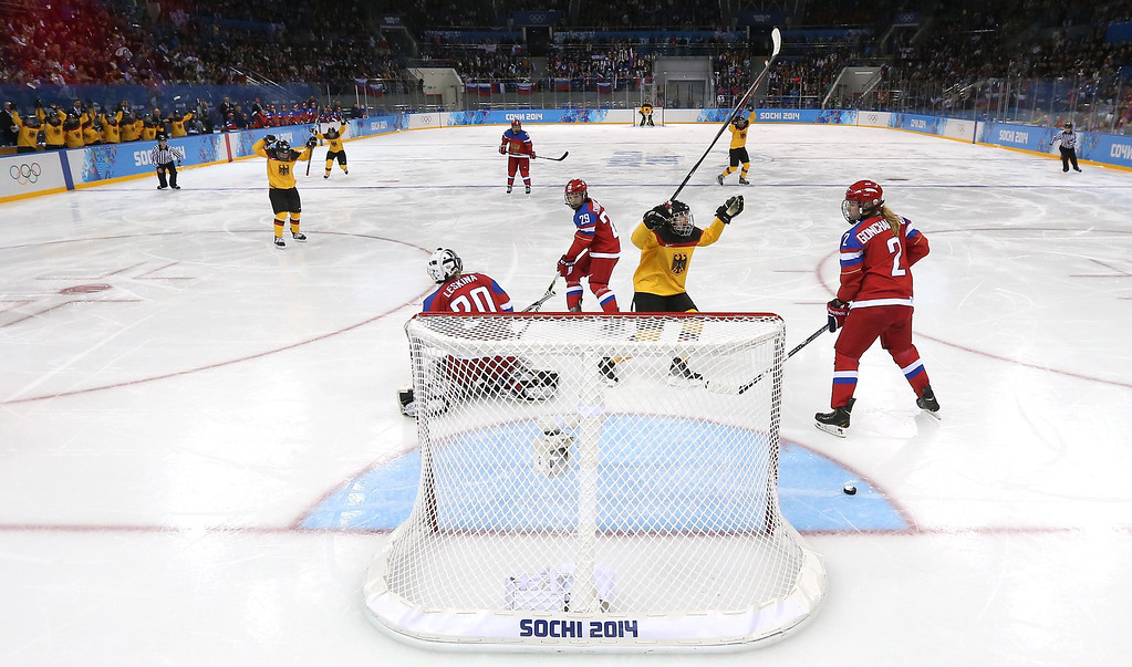 . SOCHI, RUSSIA - FEBRUARY 09:  Jacqueline Janzen #14 celebrates teammate Franziska Busch #25 of Germany goal in the second period against Yulia Leskina #20 of Russia during the Women\'s Ice Hockey Preliminary Round Group B Game on day two of the Sochi 2014 Winter Olympics at Shayba Arena on February 9, 2014 in Sochi, Russia.  (Photo by Martin Rose/Getty Images)