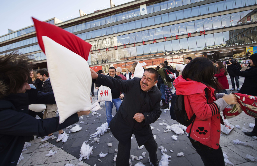 . People of different generations take part in the International Pillow Fight Day on April 5, 2014 in Stockholm, Sweden. Pillow fights take place in various places around the world on April 5, 2014. (JONATHAN NACKSTRAND/AFP/Getty Images)