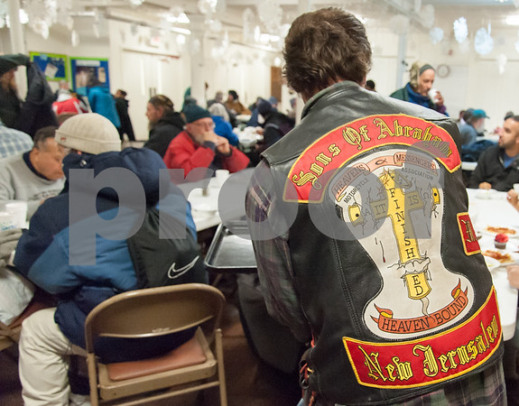 01/31/18 Wesley Bunnell | Staff The Sons of Abraham Motorcycle Association gather every Wednesday at the First Lutheran Church in New Britain to help serve meals to the homeless. Association member Greg stops at a table to deliver food.