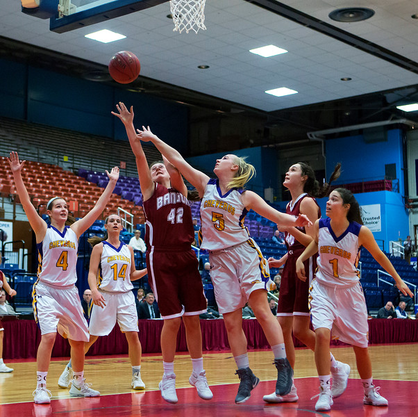 AUGUSTA, Maine -- 02/16/2017 -- Bangor's Abby Houghton (center) goes up for two past Cheverus' Michaela Jordan during their Class AA girls basketball quarterfinal game at Augusta Civic Center in Augusta Thursday. Ashley L. Conti | BDN