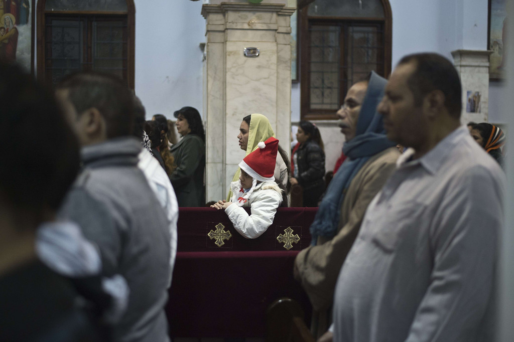 . Egyptian Coptics attend the New Year mass service at the Virgin Mary Coptic Christian church in Cairo\'s working class neighborhood of Al-Warrak on December 31, 2013.   In October 2013 four people  were gunned down as they attended a wedding at the same church in October 2013;  seventeen others wounded in the attack. KHALED DESOUKI/AFP/Getty Images