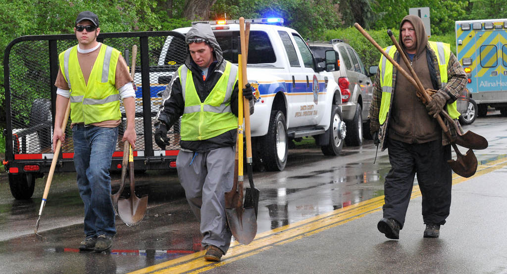 . Volunteers from the St. Paul Parks and Recreation Department leave the scene near Lilydale Regional Park. (Pioneer Press: John Doman)