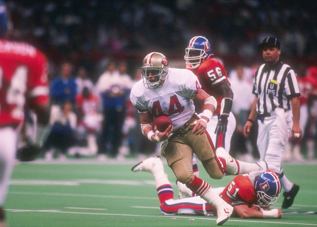 . Running back Tom Rathman #44 of the San Francisco 49ers runs the ball at Super Bowl XXIV against the Denver Broncos at the Louisiana Superdome in New Orleans, Louisiana.  (Rick Stewart/Allsport)