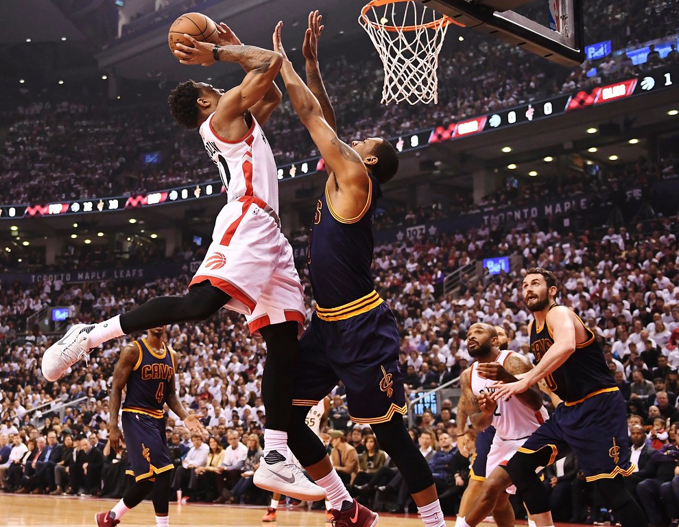 . Toronto Raptors guard DeMar DeRozan (10) shoots over Cleveland Cavaliers forward Channing Frye (8) during the first half of Game 3 of an NBA basketball second-round playoff series in Toronto on Friday, May 5, 2017. (Frank Gunn/The Canadian Press via AP)