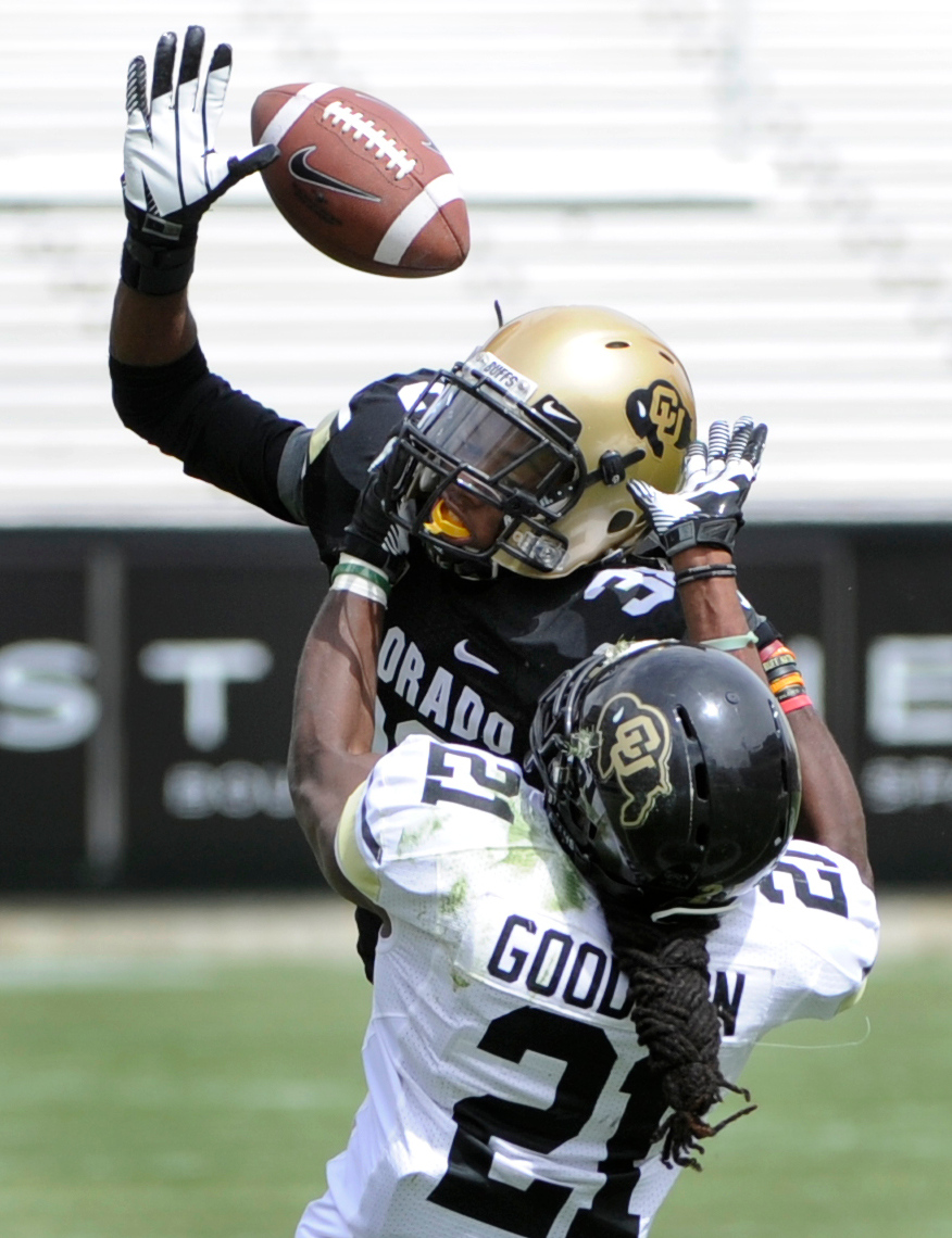 . BOULDER, CO.- APRIL13: Defensive back Alexander Stewart keeps D.D. Goodson from his reception. The University of Colorado football team hosts its spring football game at Folsom Field under the direction of new head coach Mike MacIntyre. (Photo By Kathryn Scott Osler/The Denver Post)