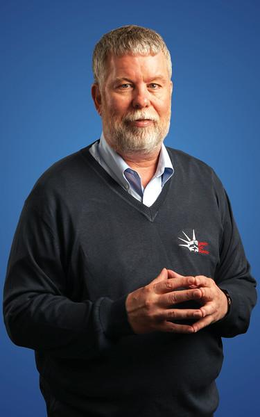 John standing in Liberty shirt.jpg