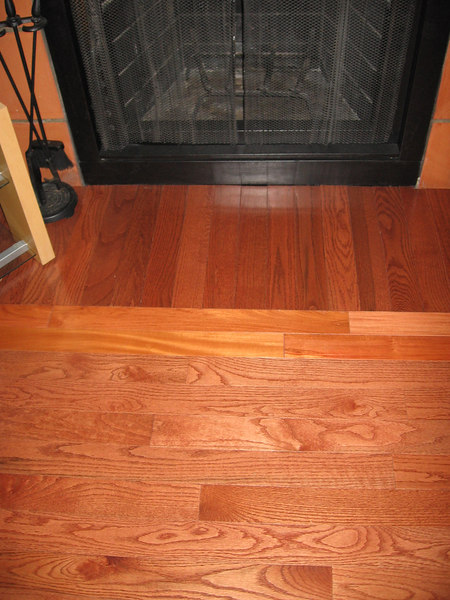 The hardwood floor pattern at the fireplace.