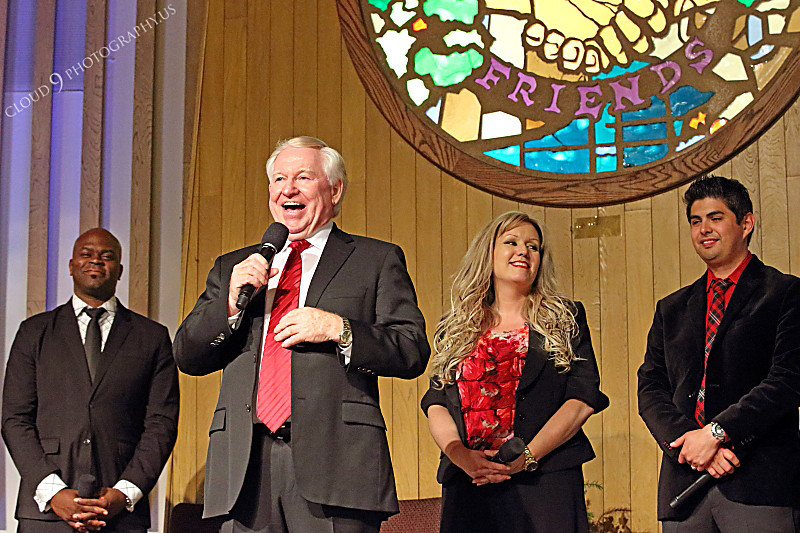 AMER-CMM 00026 Heritage Singers founder and director Max Mace stands before three other Heritage Singers members during a presentation by Peter J Mancus.JPG