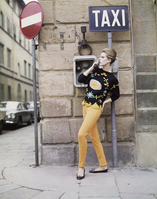 . A sports outfit, consisting of a black woolen sweater with pink, orange and turquoise floral designs, and yellow-orange woolen pants, a creation by the Ilaria Gentucca fashion house of Lucca, presented at the Florence show of Italian spring and summer fashions, Jan. 18, 1965. (AP Photo)