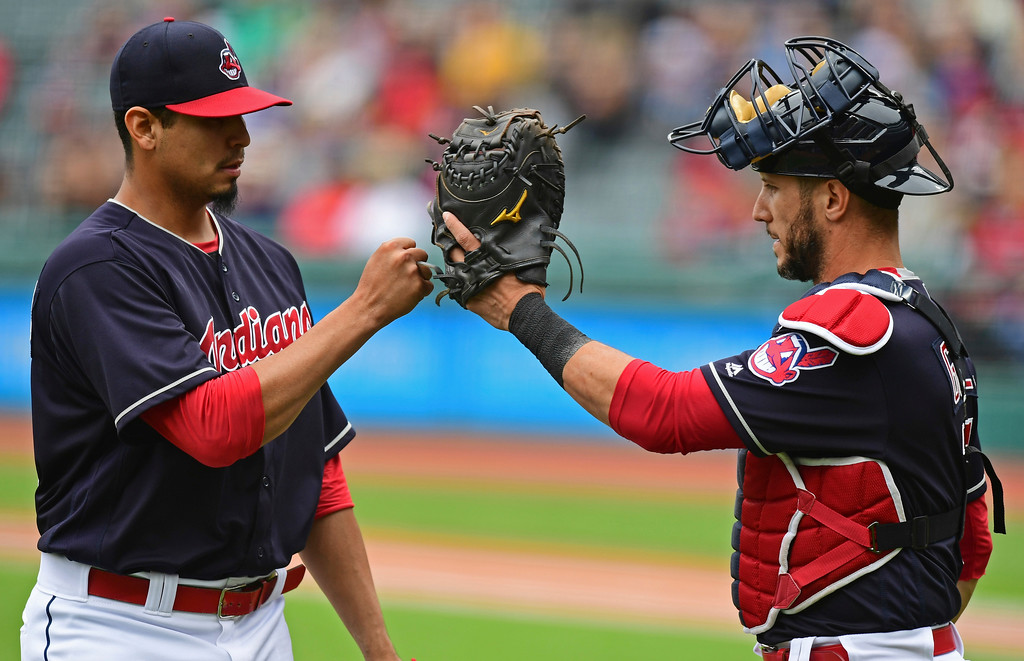 . Cleveland Indians starting pitcher Carlos Carrasco is congratulated by catcher Yan Gomes in the first inning of a baseball game against the Milwaukee Brewers, Wednesday, June 6, 2018, in Cleveland. (AP Photo/David Dermer)