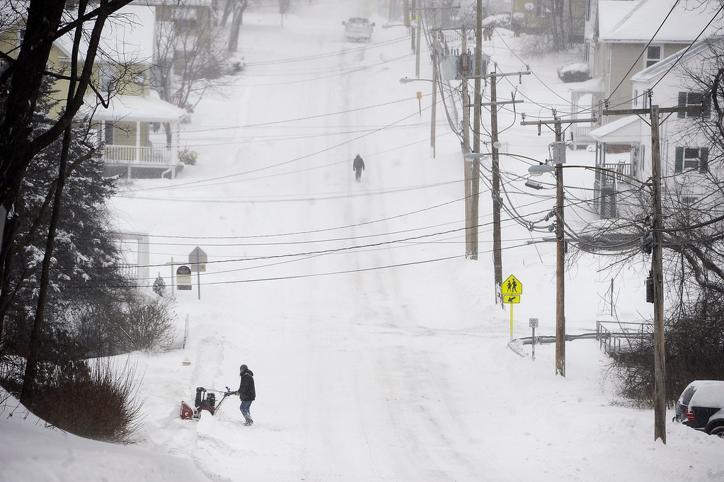 . A man clears a path with a snowblower during a snowstorm, Tuesday, Jan. 27, 2015, in Windsor Locks, Conn.   A major winter storm dropped a foot of snow or more over much of Connecticut, hitting hardest in the eastern part of the state.   (AP Photo/Jessica Hill)