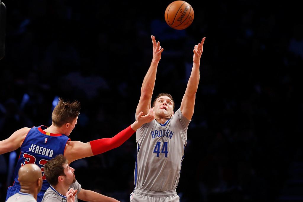 . Brooklyn Nets\' Bojan Bogdanovic (44), of Croatia, goes up for a rebound against Detroit Pistons\' Jonas Jerebko (33), of Sweden, during the fourth quarter of an NBA basketball game Sunday, Dec. 21, 2014, in New York. Brooklyn beat Detroit 110-105. (AP Photo/Jason DeCrow)