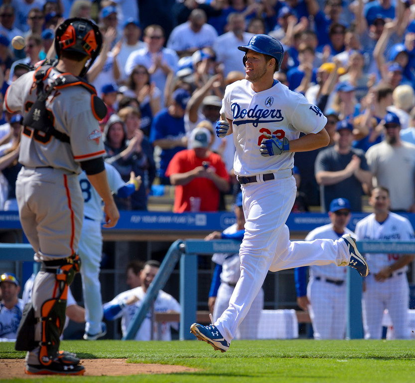 . Dodger\'s Clayton Kershaw crosses home plate after hitting a home run in the 8th inning during opening day at Dodger Stadium Monday.  Dodgers defeated the Giants 4-0.  Photo by David Crane/Los Angeles Daily News.