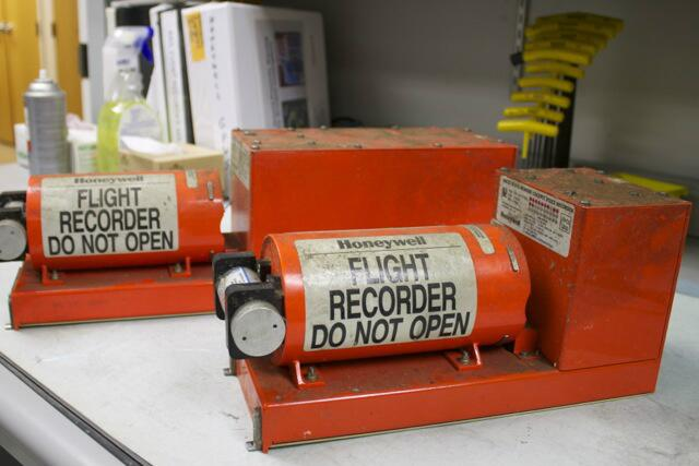 . The flight data recorder and cockpit voice recorder from the Asiana Boeing 777 are displayed in the National Transportation Safety Board laboratory in Wasnintgon, D.C., in this photograph released Sunday, July 7, 2013. Asiana Flight 214 crashed Saturday while landing at San Francisco International. Two passengers were killed and more than 100 injured. (NTSB)