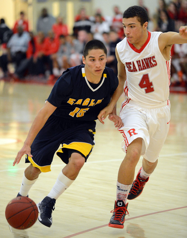 . Arroyo Grande\'s Matt Willkomm (15) drives the key against Redondo Union\'s Darrien Touchstone (3) in a CIF Southern Section Division II-A semifinal boys basketball game Tuesday night in Redondo Beach.  Redondo won the game 55-41 and advances to the title game. 20130226 Photo by Steve McCrank / Daily Breeze