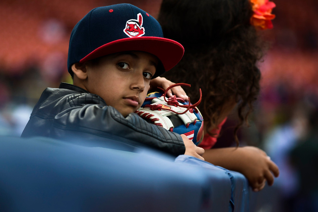 . A boy waits for an opportunity to ask for autographs before the final game of a two-game Mayor League Series between the Minnesota Twins and the Cleveland Indians at the Hiram Bithorn Stadium in San Juan, Puerto Rico, Wednesday, April 18, 2018. (AP Photo/Carlos Giusti)