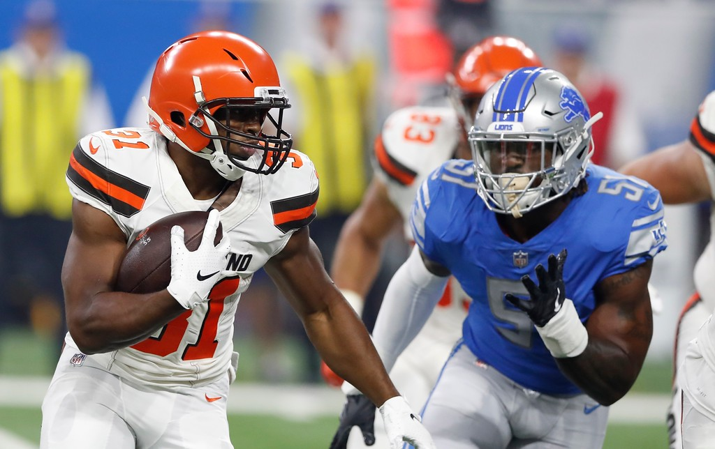 . Cleveland Browns running back Nick Chubb (31) is chased by Detroit Lions linebacker Eli Harold during the first half of an NFL football preseason game, Thursday, Aug. 30, 2018, in Detroit. (AP Photo/Carlos Osorio)