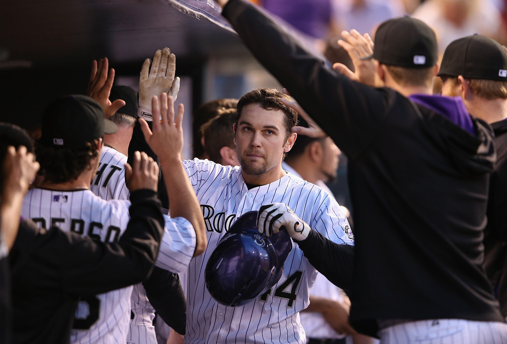 . DENVER, CO - MAY 03:  Ryan Wheeler #44 of the Colorado Rockies celebrates his solo home run off of starting pitcher Jenrry Mejia #58 of the New York Mets in the fifth inning at Coors Field on May 3, 2014 in Denver, Colorado.  (Photo by Doug Pensinger/Getty Images)