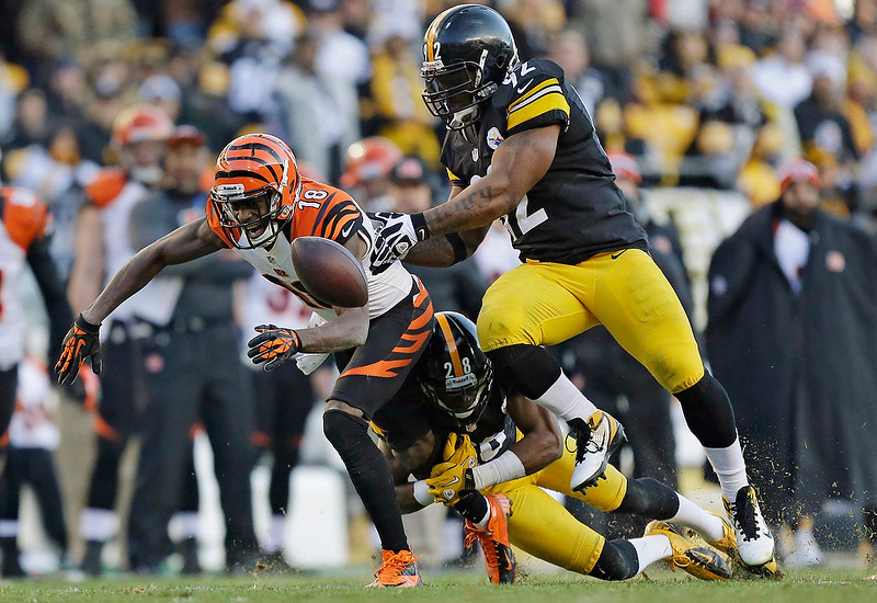 . Cincinnati Bengals wide receiver A.J. Green (18) loses the ball as he is hit by Pittsburgh Steelers cornerback Cortez Allen (28) and outside linebacker James Harrison (92) in the fourth quarter of an NFL football game in Pittsburgh, Sunday, Dec 23, 2012. The Steelers recovered the ball. (AP Photo/Gene J. Puskar)