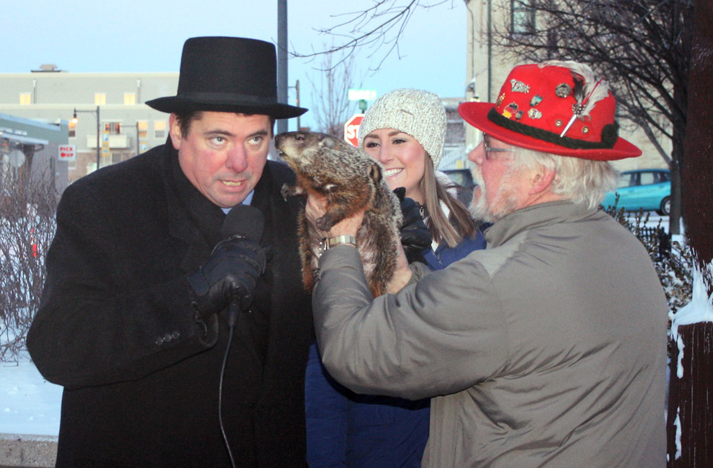 . FILE - In this Feb. 2, 2015 file photo provided by Christopher Mertes, Sun Prairie Mayor Jon Freund, left, leans in for Jimmy\'s prognostication just before being bitten on ear by the groundhog during the Groundhogs Day celebration in Sun Prairie, Wis. While photos and video of Freund got plenty of notice, the incumbent mayor didn�t get the votes he needed in the Tuesday, Feb. 17  primary election.  He finished third in a field of three and is out of the Sun Prairie mayor�s race. (AP Photo/The Star, Christopher Mertes, File) MANDATORY CREDIT