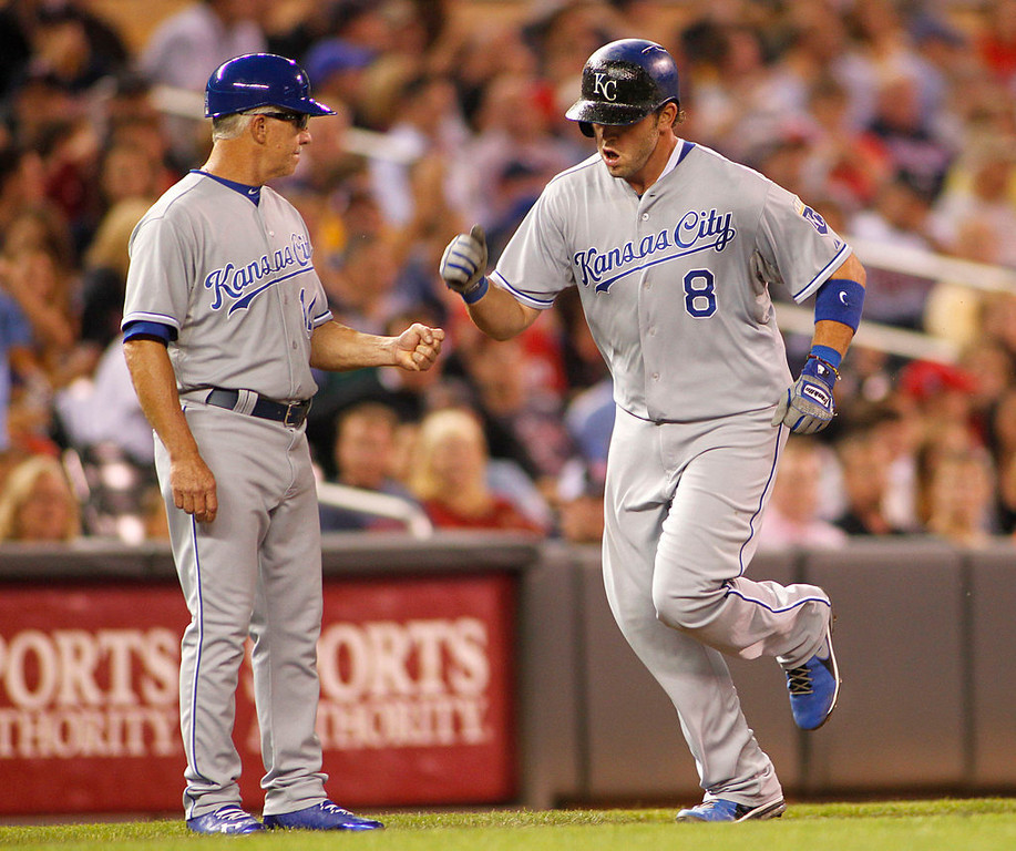 . Kansas City Royals\' Mike Moustakas, right, is congratulated by third base coach Eddie Rodriquez after hitting a solo against the Minnesota Twins during the eighth inning. (AP Photo/Andy King)