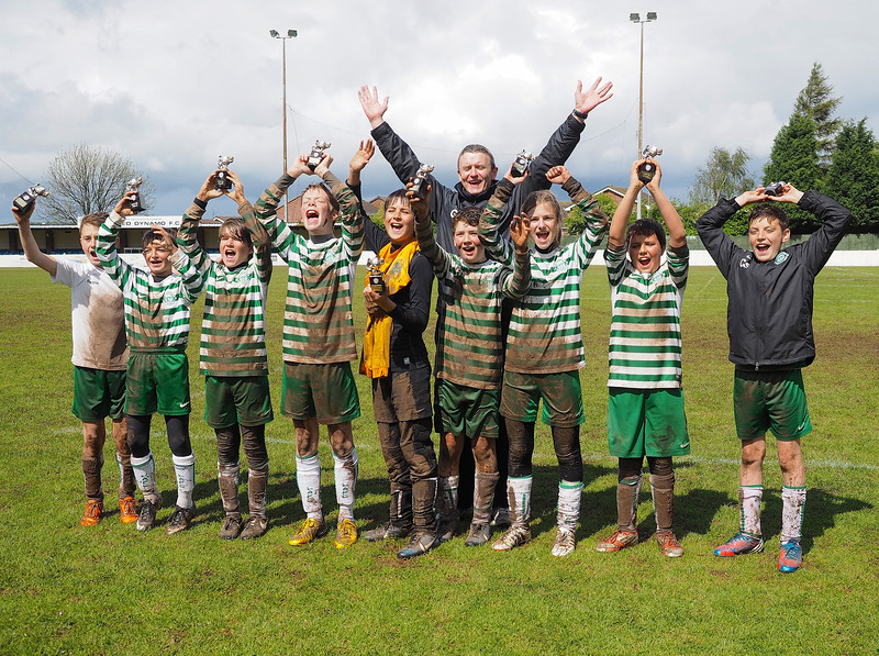 Lutterworth Athletic U12's winners with trophies and manager Gavin Brindley.