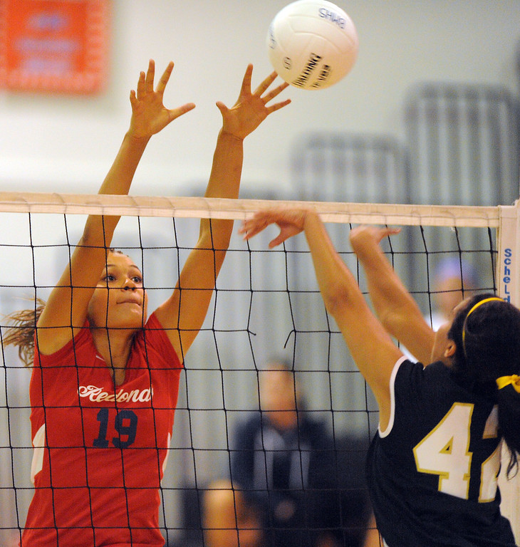 . Redondo girls volleyball takes on Bishop Montgomery in a non league match in Torrance on 09/10/2013. Redondo won 3-0. Bishop\'s Stephany Garcia, right, hits the ball just out of reach of Redondo\'s Briana Lanktree. (Photo by Scott Varley, Daily Breeze)