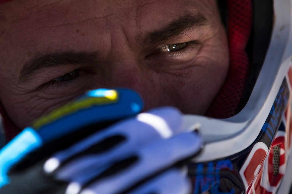 . KTM rider Marc Coma, from Spain, adjusts his helmet before the start of fourth stage during the Dakar Rally 2015 between Chilecito, Argentina and Copiapo, Chile, Wednesday, Jan. 7, 2015. The race will finish on Jan. 17, passing through Bolivia and Chile and returning to Argentina. (AP Photo/Felipe Dana)
