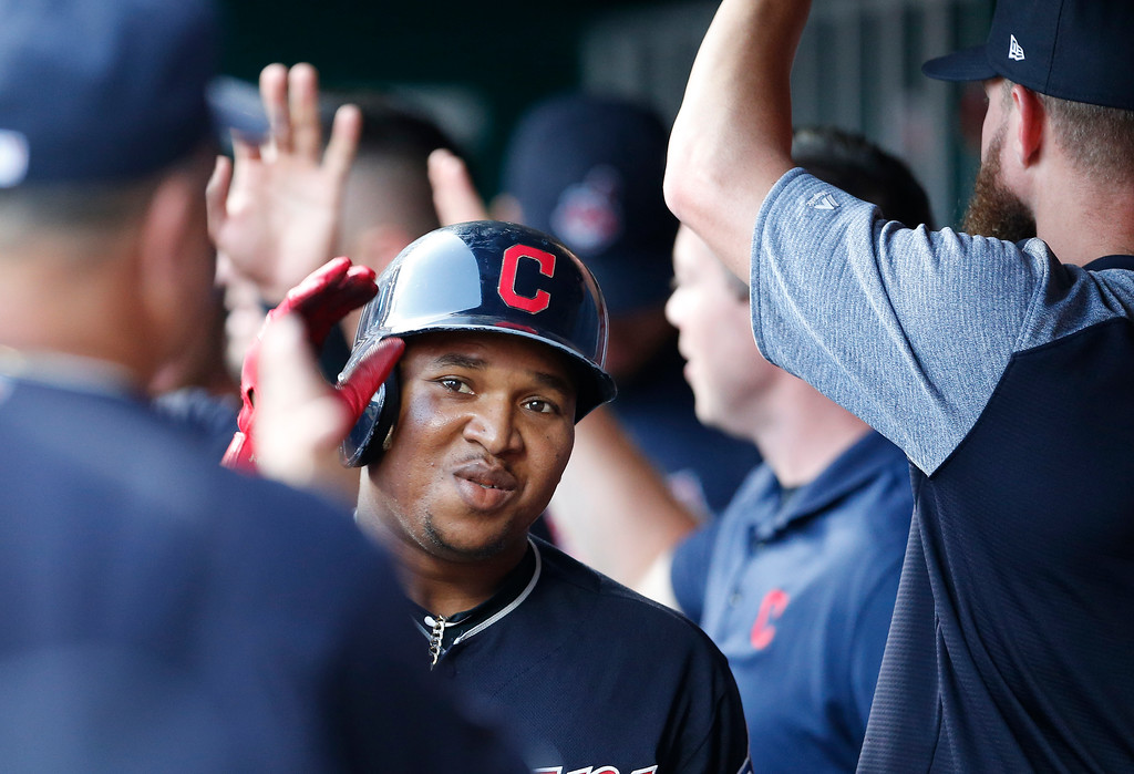 . Cleveland Indians\' Jose Ramirez, center, celebrates a two-run home run off Cincinnati Reds starting pitcher Homer Bailey during the third inning of a baseball game, Monday, Aug. 13, 2018, in Cincinnati. (AP Photo/Gary Landers)