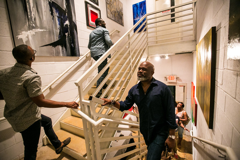 Orlando Vargas' work is on display at Escape Gallery, a space that extends the length of a stairwell.  The artist is studying industrial engineer and was onsite to host the show.  The Castleberry Hill Art Stroll is the second Friday of every month.  Galleries, shops, art openings, music and interactive art is all avaiable for the general public monthly in Castleberry.  (Jenni Girtman / Atlanta Event Photography)