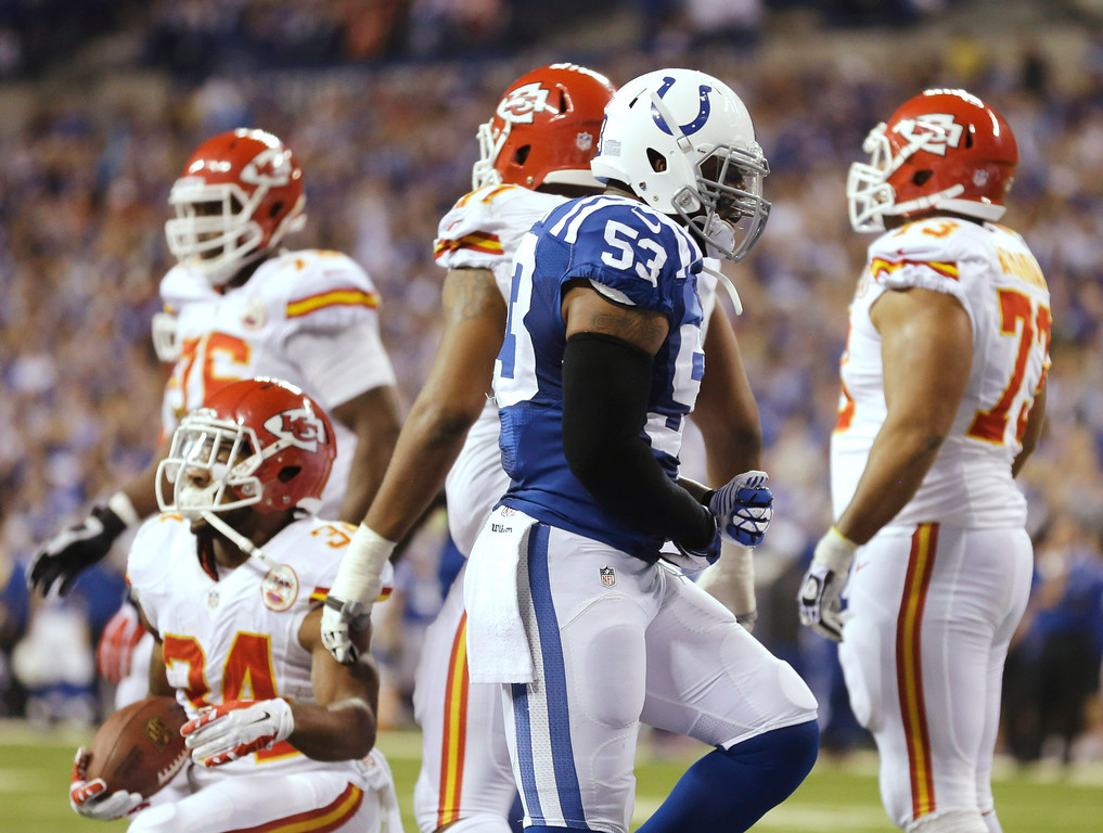 . Indianapolis Colts inside linebacker Kavell Conner (53) after a tackle on Kansas City Chiefs running back Knile Davis (34) during the first half of an NFL wild-card playoff football game Saturday, Jan. 4, 2014, in Indianapolis. (AP Photo/Michael Conroy)