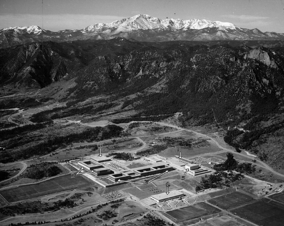. In its nook against the Ramoart Range of the Rockies in 1960, the academy has the polished appearance it likes to see in its students. Numbers in the photo above locate these points: 1) Mitchell Hall (cadet dining room); 2) Fairchild Hall (academic-library building); 3) Vandenberg Hall (dormitory; 4) Harmon Hall (administration building); 5) Arnold Hall, (social center); and 6) the physical education building. The Denver Post Library Archive