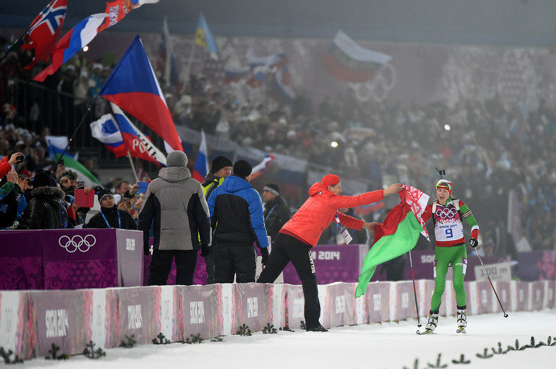 . Darya Domracheva of Belarus celebrates winning the Women\'s 10 km Pursuit during day four of the Sochi 2014 Winter Olympics at Laura Cross-country Ski & Biathlon Center on February 11, 2014 in Sochi, Russia.  (Photo by Harry How/Getty Images)