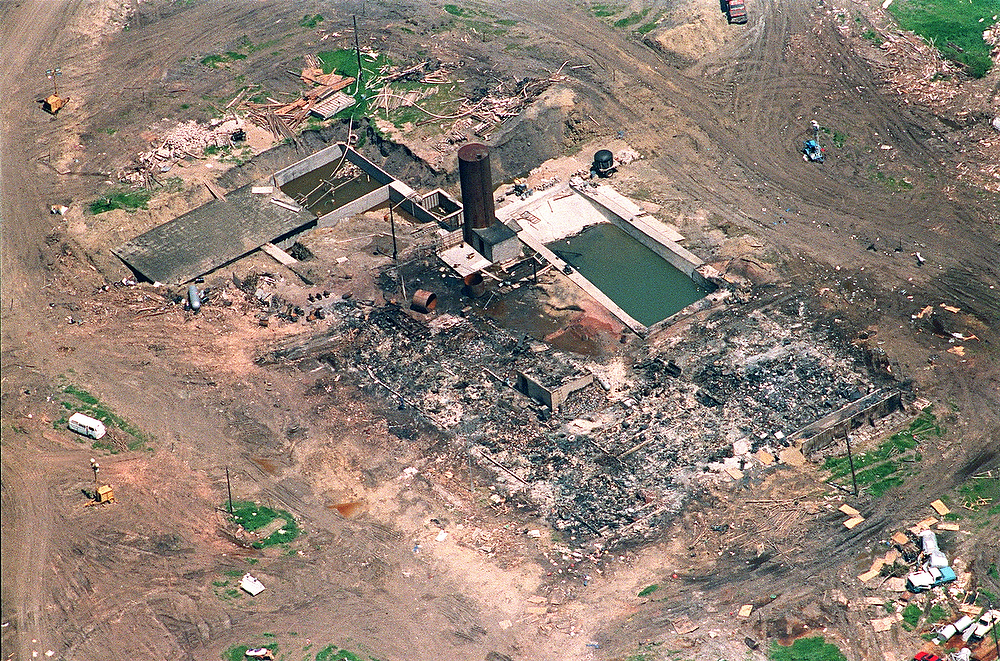 Description of . An aerial shot of the burnt remains of the Branch Davidian compound on April 21, 1993. After a shootout in Waco in 1993 that killed four federal agents and six members of the Branch Davidian religious sect, authorities negotiated with cult leader David Koresh for 51 days. On the final day, April 19, 1993, a few hours after a government tank rammed the cult's wooden fortress, the siege ended in a fiery blaze, killing Koresh and 80 of his followers. Authorities later learned that leader David Koresh had renamed the compound Ranch Apocalypse and prophesied that the end of days from the Bible's Book of Revelations would begin there.   J. DAVID AKE/AFP/Getty Images