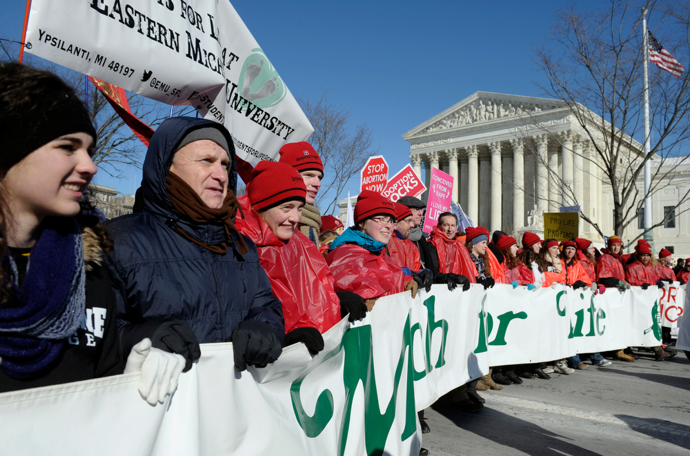. Anti abortion demonstrators lead the annual March for Life Rally near the Supreme Court in Washington, Wednesday, Jan. 22, 2014. Thousands of abortion opponents are facing wind chills in the single digits to rally and march on Capitol Hill to protest legalized abortion, with a signal of support from Pope Francis. (AP Photo/Susan Walsh)