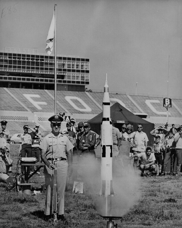 . Col. James Lannon, Air Force Academy chief of staff, fires a Saturn 5 scale model rocket to signal start of the 11th annual National model rocketry competition being held this week at AFA. The model is 1-100th the size of real one. 1969. The Denver Post Library Archive