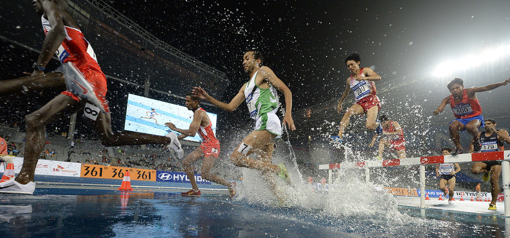 . Competitors clear the water jump in the final of the men\'s 3000m steeplechase athletics event during the 17th Asian Games at the Incheon Asiad Main Stadium in Incheon on September 29, 2014. MARTIN BUREAU/AFP/Getty Images