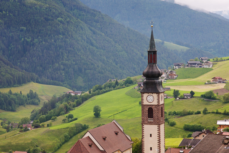 San Pietro Clock Tower in Val di Funes, a lovely green valley