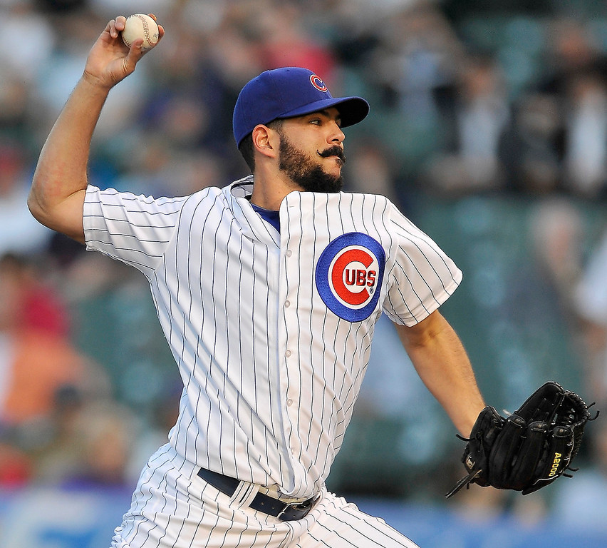 . Chicago Cubs starter Carlos Villanueva delivers a pitch against the Colorado Rockies during the first inning of a baseball game in Chicago, Tuesday, May 14, 2013. (AP Photo/Paul Beaty)
