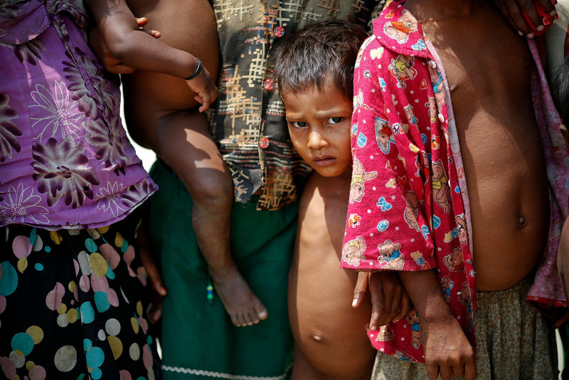 . Rohingya Muslim children gather at a camp for those displaced by violence, near Sittwe April 28, 2013. Myanmar must urgently address the plight of Muslims displaced by sectarian bloodshed in western Rakhine State and double the number of security forces to control the still-volatile region, an independent commission said on Monday. Its long-awaited report recommended a mixed bag of humanitarian and security responses to violence last June and October that killed at least 192 people and left 140,000 homeless, mostly stateless Rohingya Muslims in an area dominated by ethnic Rakhine Buddhists. Picture taken April 28, 2013.  REUTERS/Damir Sagolj