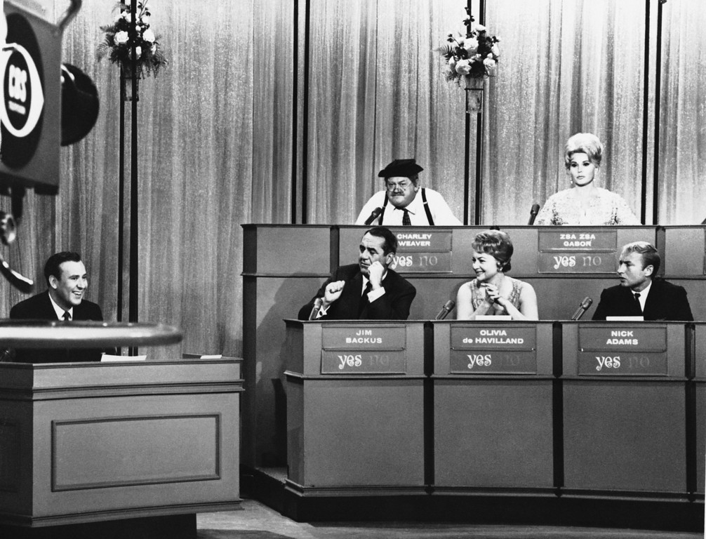". Carl Reiner (left) acts as host on March 26, 1965 ""The Celebrity Game\"" which will return to the CBS TV broadcasts starting April 8.   Guest panelists are Jim Backus, Olivia De Havilland and Nick Adams in the front row.  Back row panelists are Charley Weaver and Zsa Zsa Gabor.  They all will appear in some of the broadcasts. (AP Photo)"