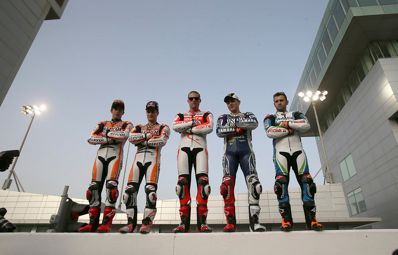 . (L-R) Honda MotoGP riders Marc Marquez and Dani Pedrosa of Spain, Ducati MotoGP rider Ben Spies of the U.S., Yamaha MotoGP rider Jorge Lorenzo of Spain and FTR MotoGP rider Hector Barbera of Spain pose for a group photo before the free practice session of the MotoGP World Championship at the Losail International circuit in Doha April 4, 2013. REUTERS/Fadi Al-Assaad