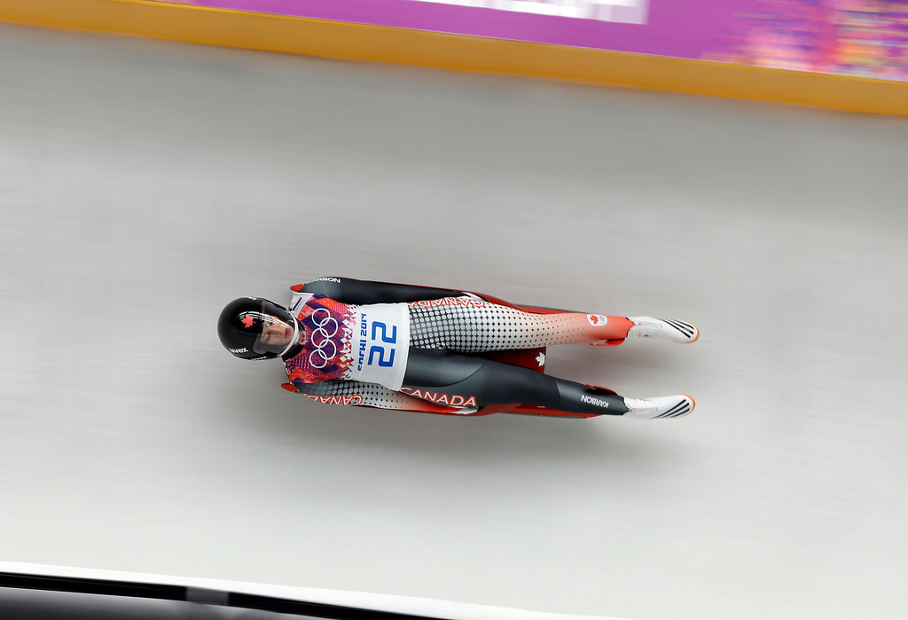 . Arianne Jones of Canada speeds down the track in her second run during the women\'s singles luge competition at the 2014 Winter Olympics, Monday, Feb. 10, 2014, in Krasnaya Polyana, Russia. (AP Photo/Natacha Pisarenko)