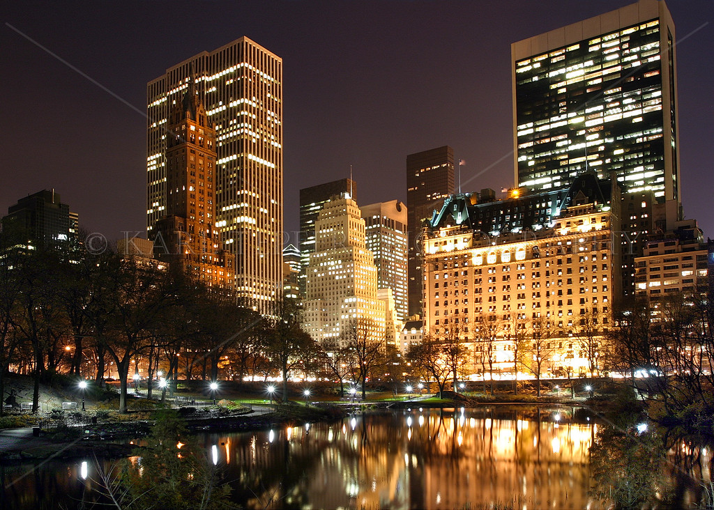 Central Park, Manhattan, New York City at night. Plaza Hotel in the background.