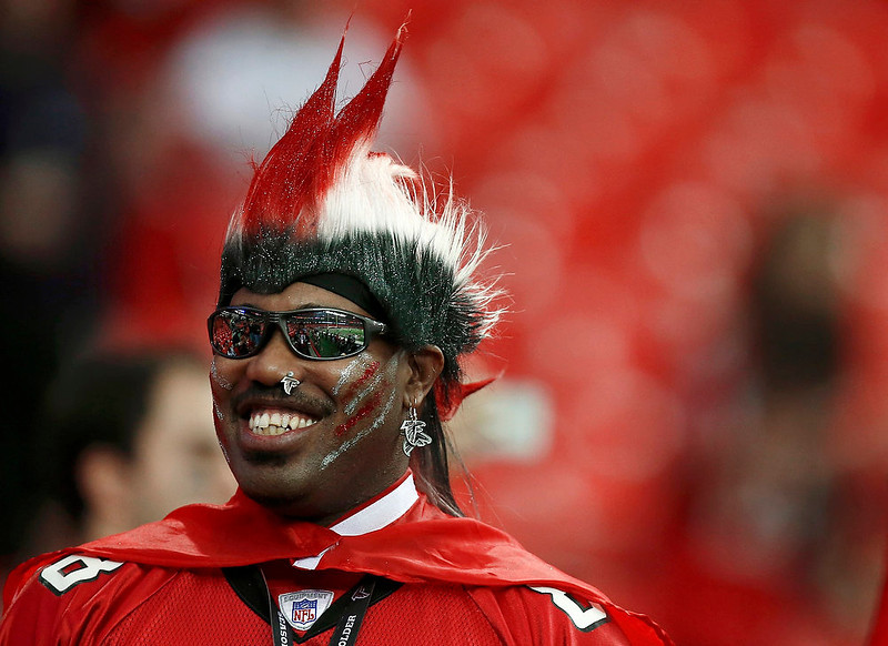 . An Atlanta Falcons fan waits in the stands before the NFL NFC Divisional playoff football game between the Atlanta Falcons and the Seattle Seahawks in Atlanta, Georgia January 13, 2013. REUTERS/Chris Keane