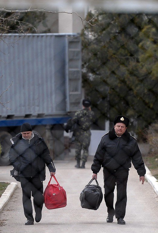 . Ukrainian officers walk with their bags as they leave the Ukrainian navy south headquarters base in Novoozerne after it was taken over by Russian forces on March 19, 2014.  AFP PHOTO/ Filippo MONTEFORTE/AFP/Getty Images