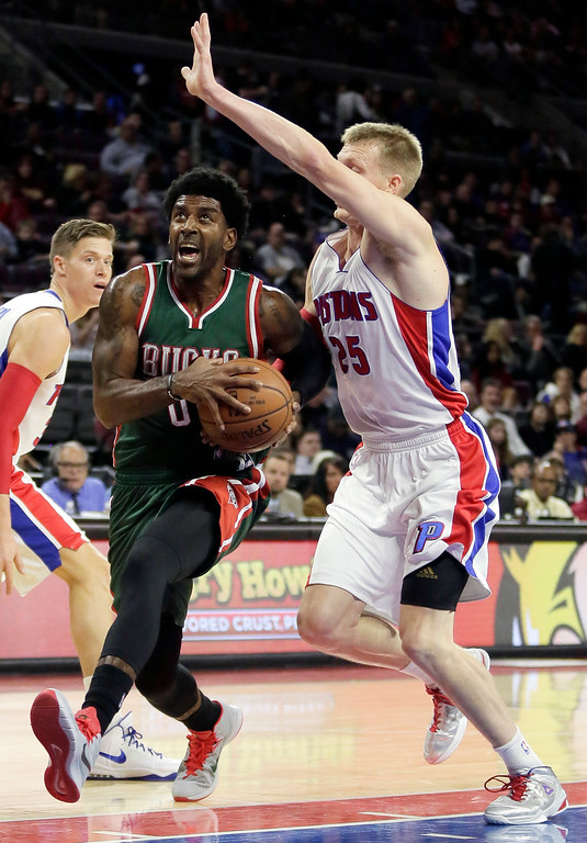 . Milwaukee Bucks\' O.J. Mayo,front left, drives to the basket past Detroit Pistons\' Kyle Singler (25) during the first half of an NBA basketball game Friday, Nov. 7, 2014, in Auburn Hills, Mich. (AP Photo/Duane Burleson)