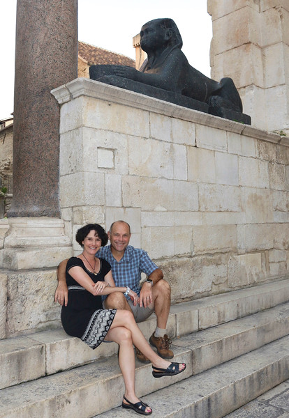 Just us sitting under a 3,500 year-old sphinx that Diocletian plundered from Egypt — at Diocletian's Palace.