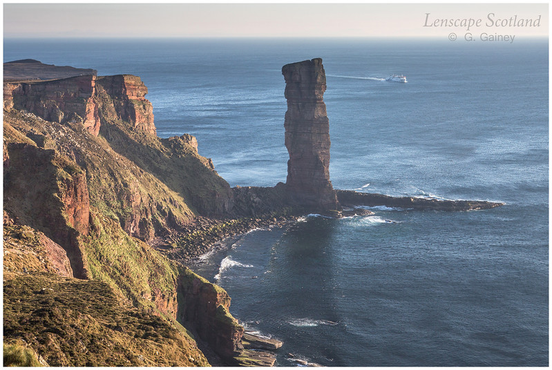Stromness ferry below the Old Man of Hoy, Orkney