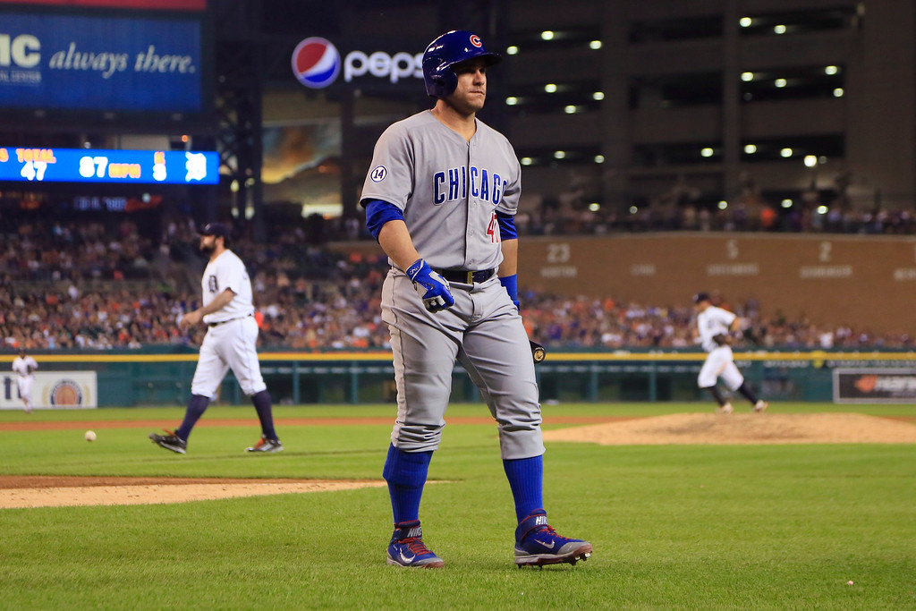 . Chicago Cubs\' Miguel Montero walks back to the dugout after striking out to end the eighth inning with bases loaded in a baseball game against the Detroit Tigers, Tuesday, June 9, 2015, in Detroit. (AP Photo/Carlos Osorio)
